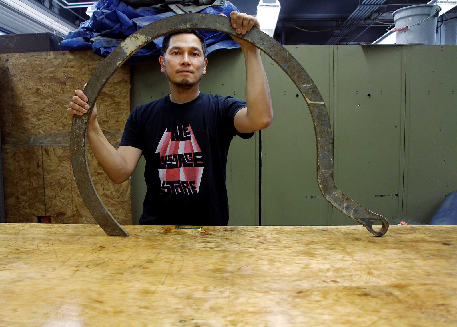 Professor Arcega stands with a sculpting tool in the sculpting lab at San Francisco State on Thursday, August 22nd. Arcega is a new professor part of the art department teaching Sculpting 1 and 2 this semester. Photo by Gavin McIntyre / Xpress