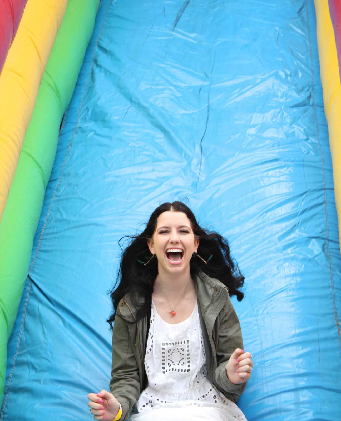 Nicole Santoni, Sophomore, slides down an inflatable slide at the SF State ASI Kick-Off on Wednesday, Sept. 4, 2013. The Kick-Off was carnival themed, having ring toss, cotton candy, inflatable slides and other carnival classics. Photo Ryan Leibrich / Xpress