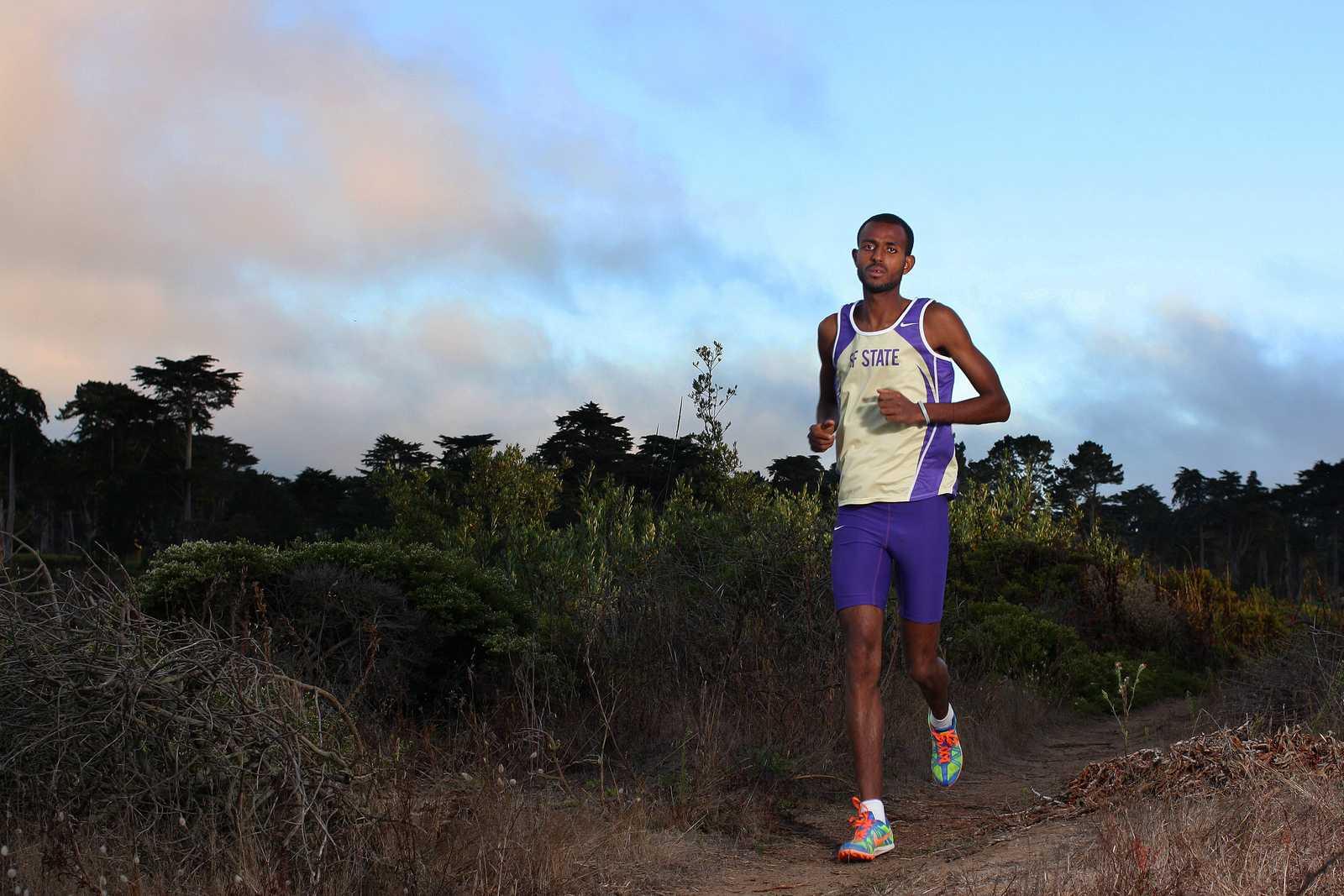 Senior cross country runner Bruk Assefa poses for a portrait near Lake Merced on August 30, 2013. Photo by Tony Santos / Xpress