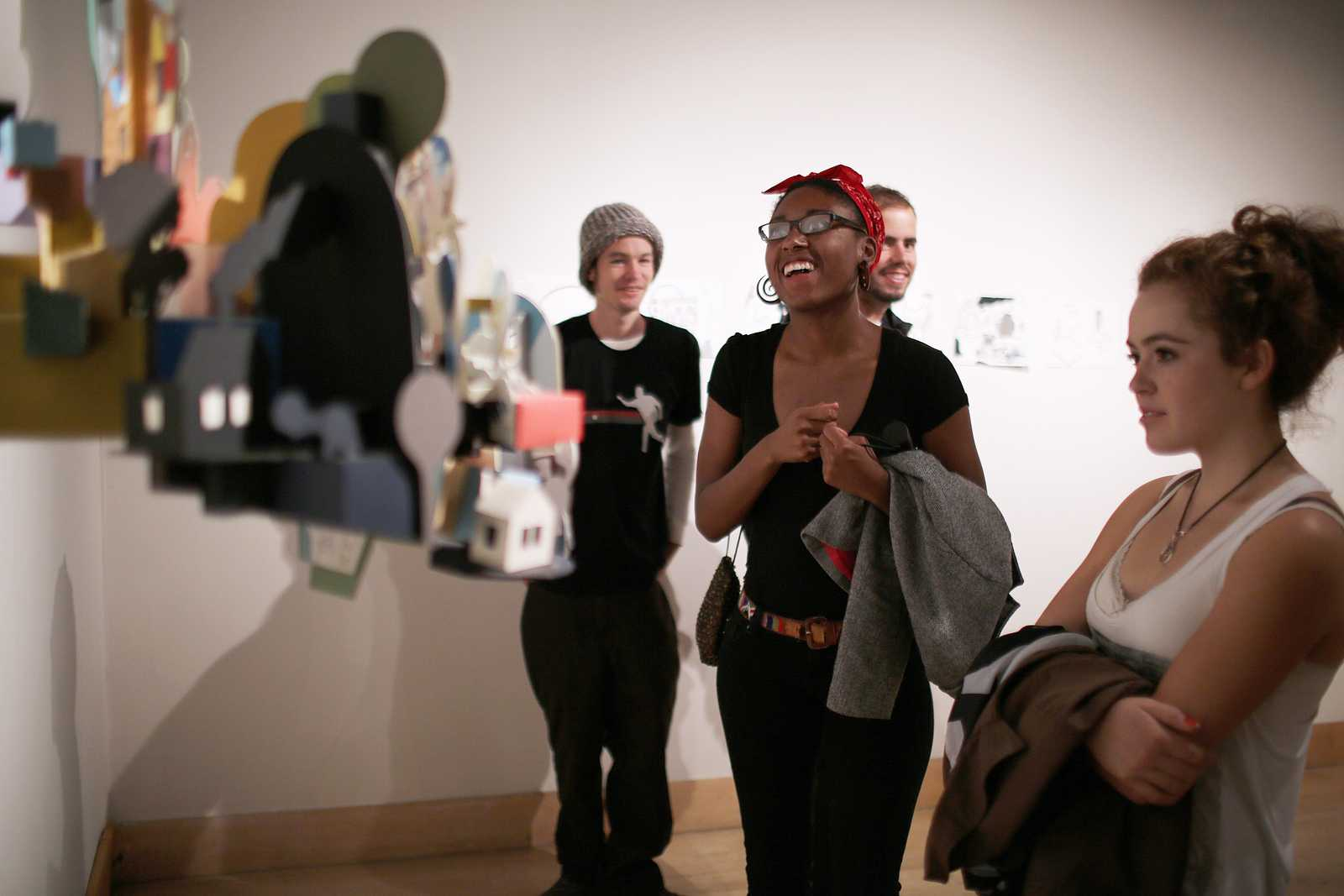 (Right to left) Shanna Irving and Shanti Mason look at an art piece on display at