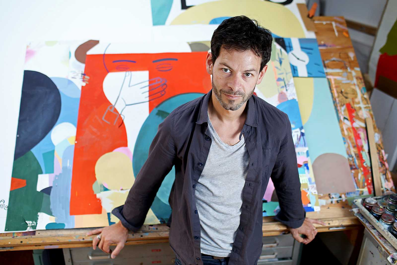 Jason Jägel, a San Francisco based local artist who is featured in the Illuminated Library Exhibit at SF State, stands in his studio located in the Mission District. Photo by Virginia Tieman / Xpress