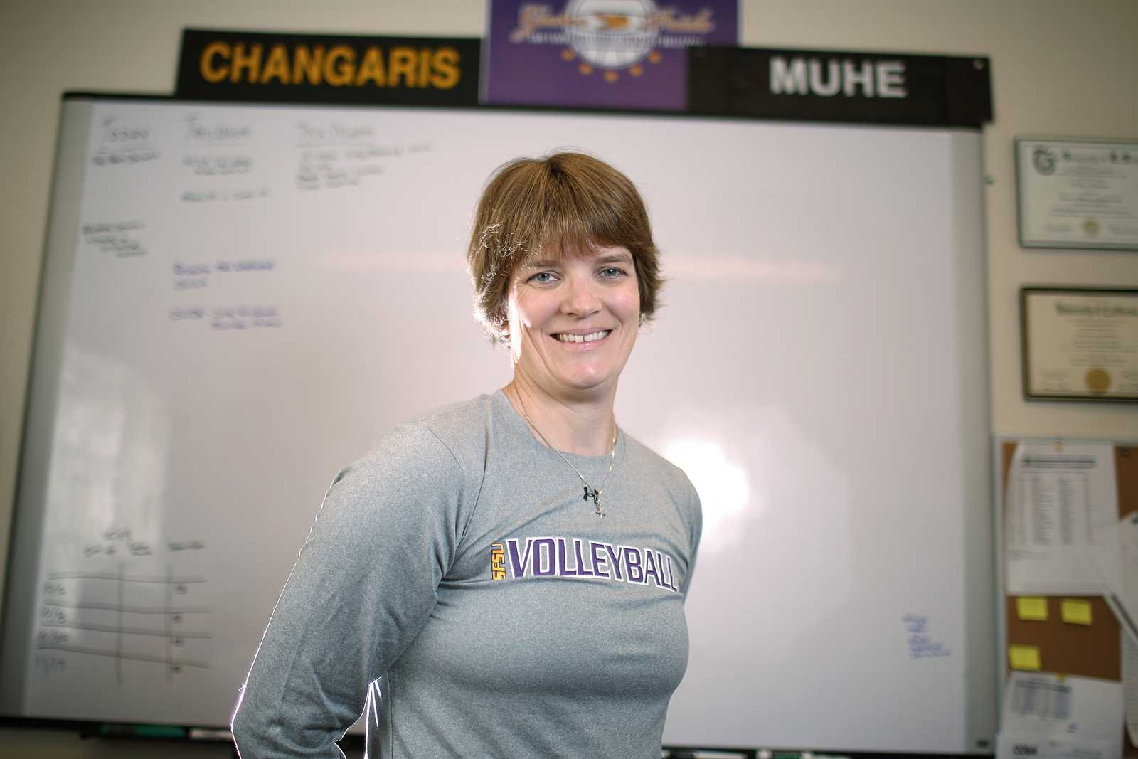 Jill Muhe, new head coach for the SF State women's volleyball team, stands in her office in the Gymnasium of SF State. Muhe recently came to SF State from Briar Cliff University in Iowa.  Photo by John Ornelas / Xpress