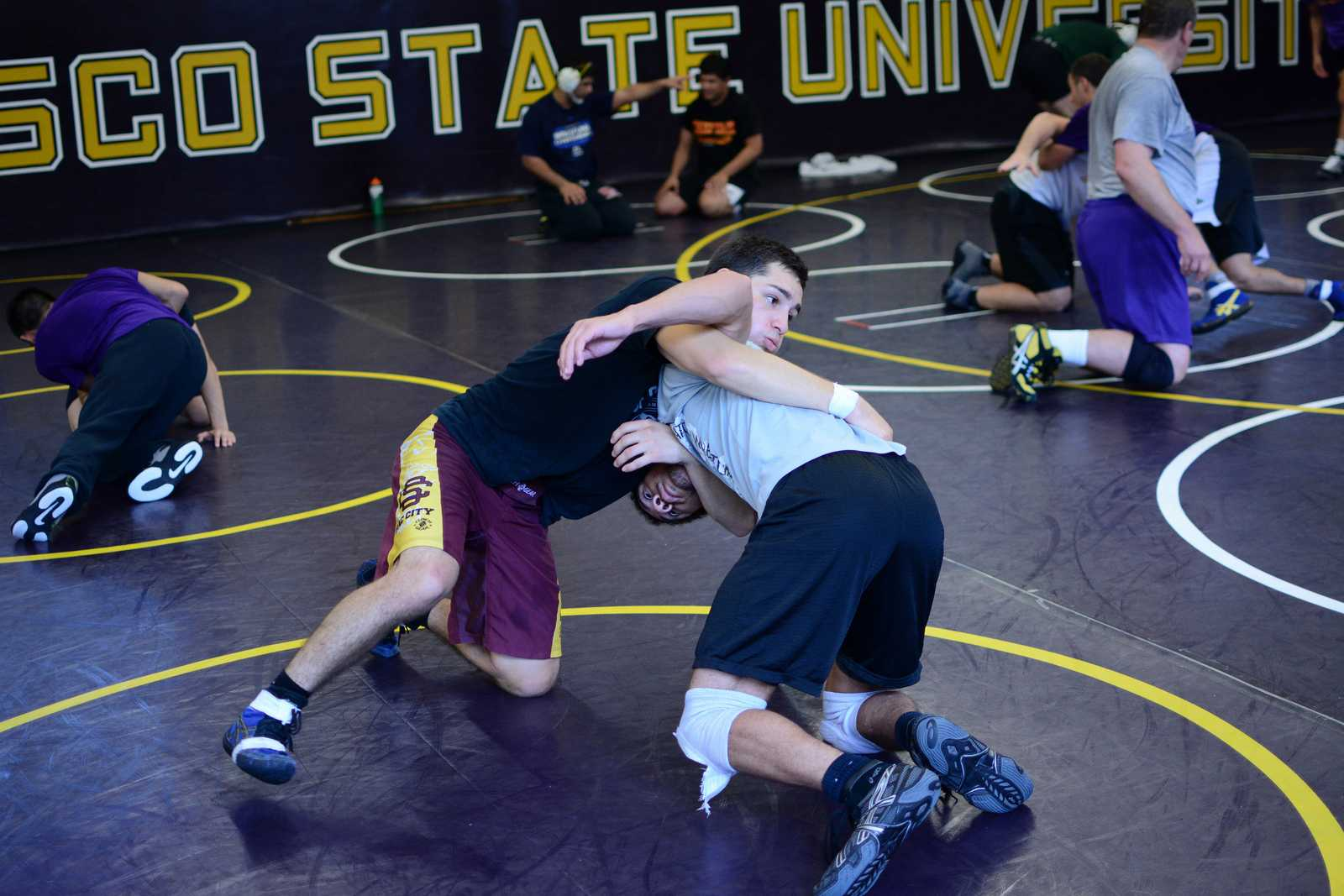 Senior Isaiah Hurtado (left), wrestles with senior Alex Williams (right), during practice at SF State on Friday, Oct. 11, 2013. Photo by Philip Houston / Xpress