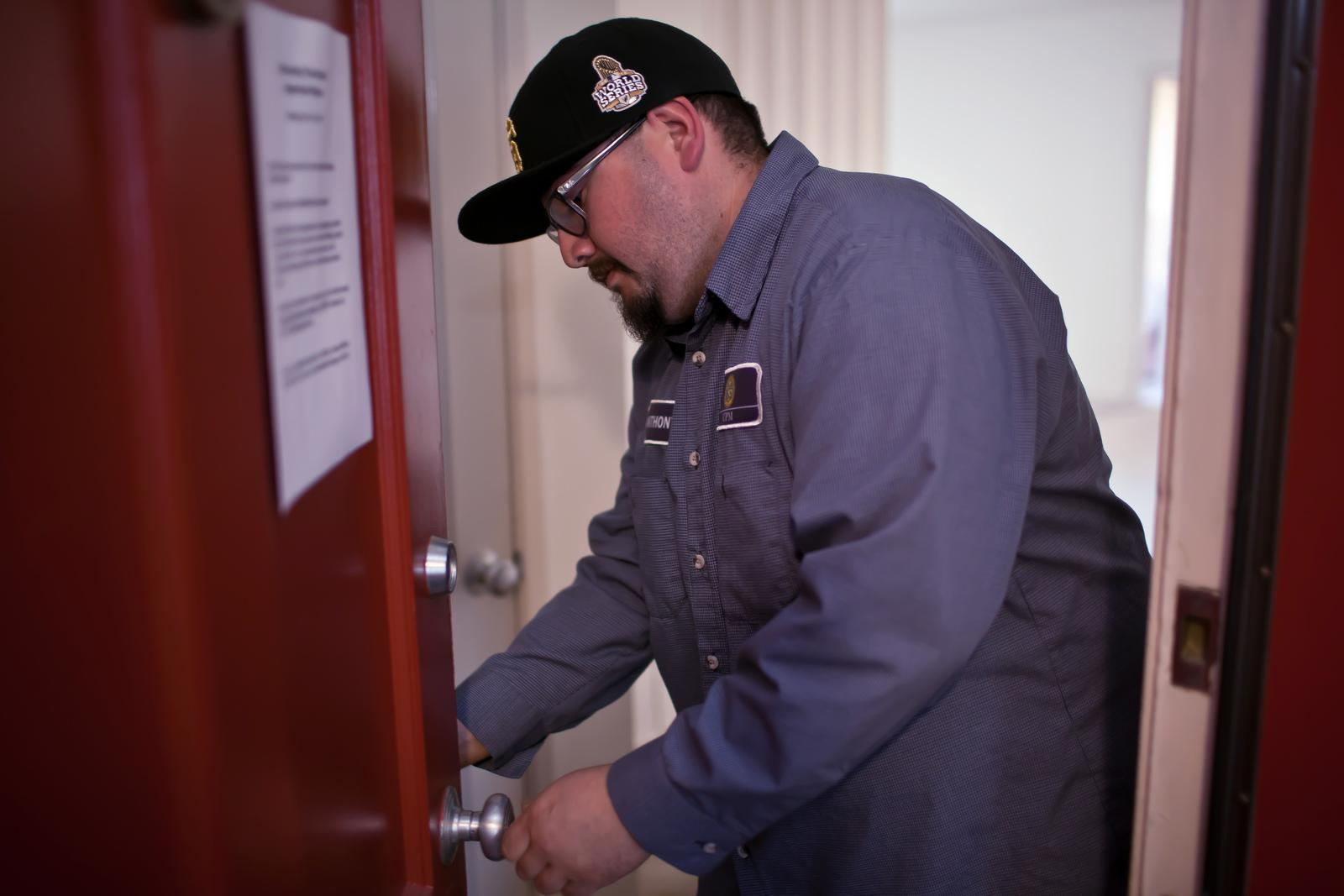 University employee, Andrew Cobo-Mier, changes the lock on a vacant apartment in University Park North on Tuesday, Oct. 29. The lock change is the first of over 1,300 that will be performed in the next few days in response to a stolen master key. Photo by Dariel Medina / Xpress.