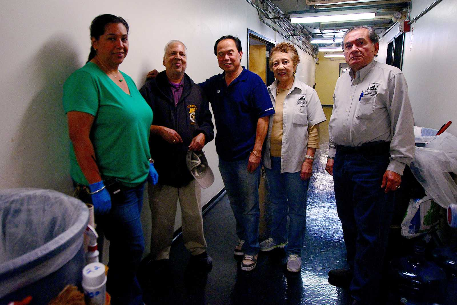 Erika Santos, Naresh Mathur, Bernie Carrera, Maria Suarez and Carlos Rosales pose for a photo in the basement of Cesar Chavez Wednesday Oct 30, 2013. The unionized custodial staff of Cesar Chavez Student Center are unsure where their union will stand following a campus auxiliary merger. Photo by Kate O'Neal / Xpress