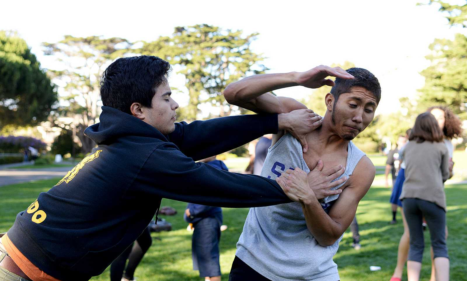 Oscar Hernandez (left) practices Krav Maga moves with Micky Mejia (right) during a Women's Center sponsered event where self defense was taught to participants in the Quad at SF State on Thursday, Nov. 7, 2013. Photo by Virginia Tieman / Xpress