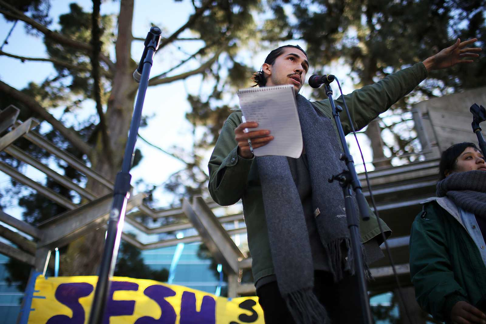 Michael Sanchez speaks to students about Tasers in Malcolm X Plaza during a rally Dec. 5. The rally was organized by a group of student organizations. Photo by John Ornelas / Xpress.