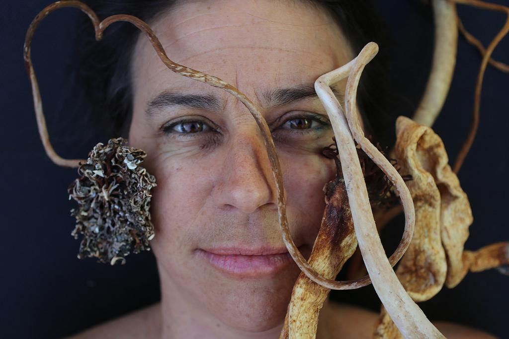 Josie Iselin, a photographer, artist, and book designer makes intimate portraits of seaweed, trash, stones, and just about anything she finds at the beach by scanning them. Photo by Rachel Aston / Xpress.