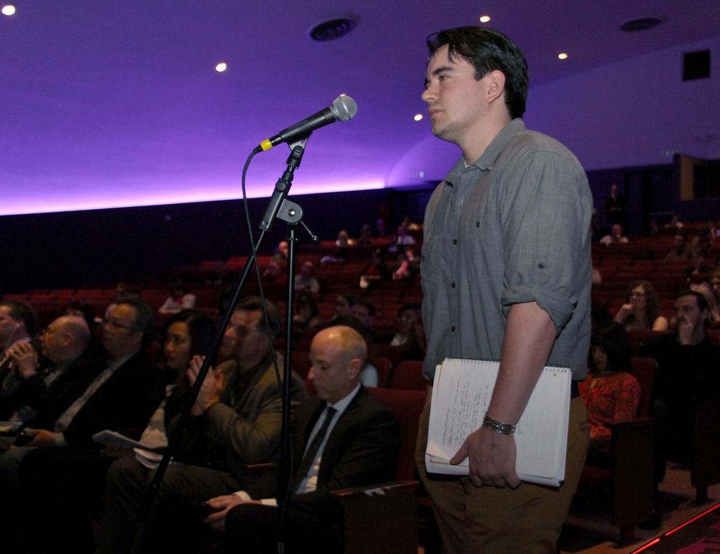 Michael Buelna, a Zoology major, asks a question to the speakers at the town hall meeting on the science building closure, in SF State's McKenna Theatre, Feb. 13, 2014. Buelna has had a few classes in the science building. Photo by Gavin McIntyre / Xpress