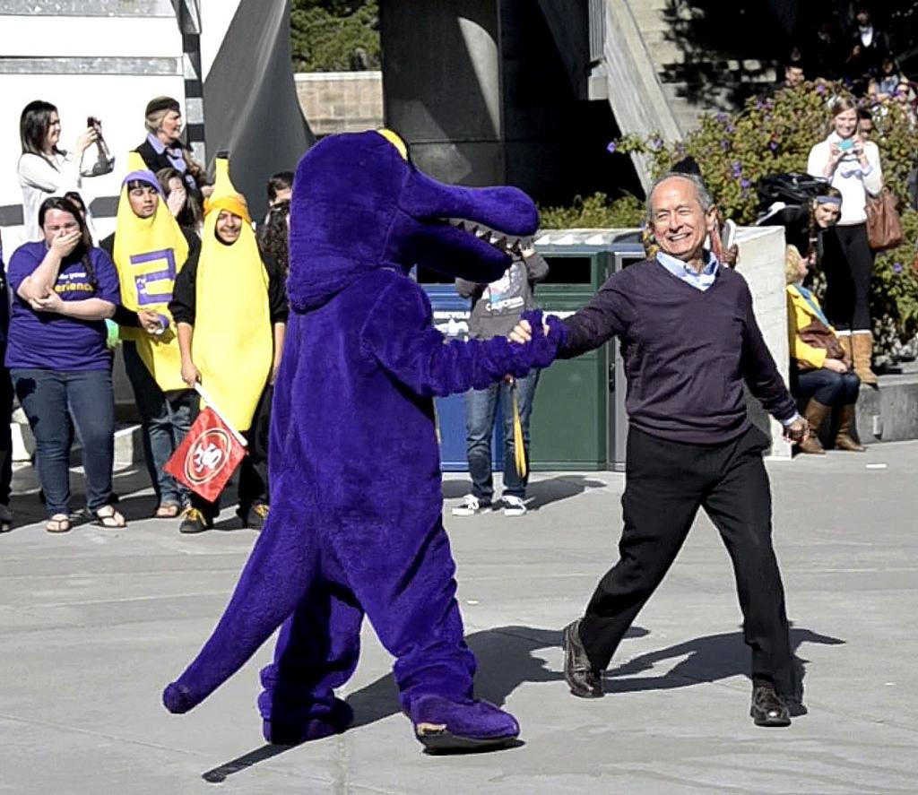 University President Leslie E. Wong dances with the SF State gator mascot at Malcolm X Plaza on Friday, Feb. 22, 2013 in preparation for the second SF State Harlem Shake video. Photo by Virginia Tieman / Xpress, 2013