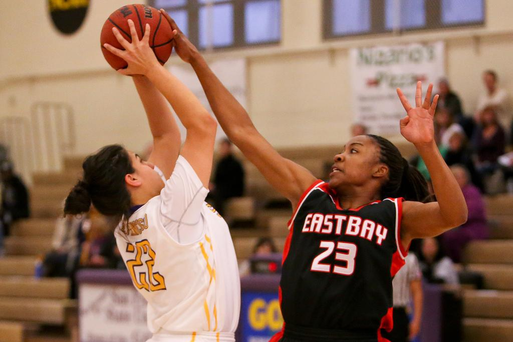 SF State Gator Leticia Galarza (22) tries to shoot in the paint during the women's basketball game against Cal State East Bay Pioneers at The Swamp on Friday Feb. 28. The Gators lost 50-58. Photo by Gabriella Gamboa / Special to Xpress