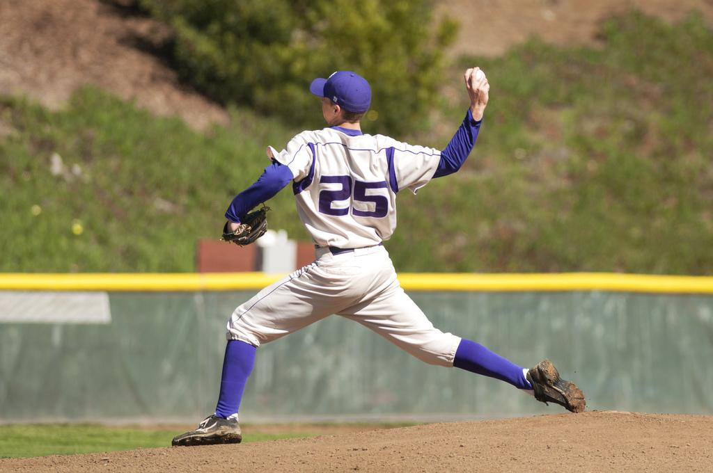 SF State's Preston Tater pitches the ball during the home game against CSU Monterey Bay at Mahoney Field Friday, March 7. Photo by Jessica Christian / Xpress