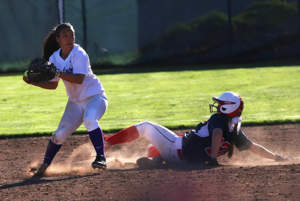 SF State's Kelsey Murakami throws the ball to first base against Dixie State Tuesday, March 11 at SF State's softball field. SF State lost 1-4. Photo by Rachel Aston / Xpress