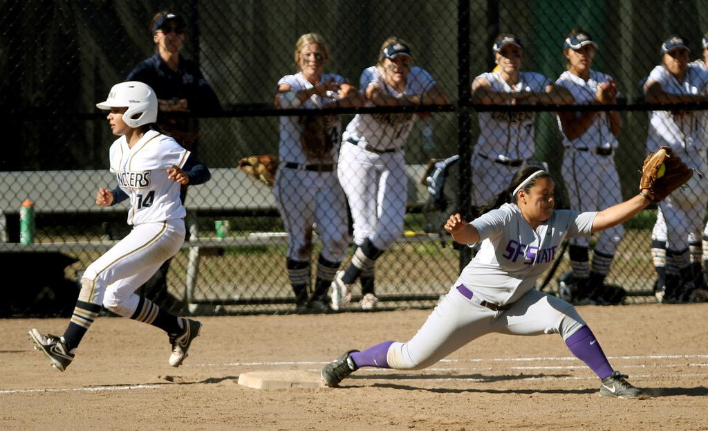 SF State's Selina Rodriguez(24) tags out Cal Baptist's Jacque Lopez(14) at first base during the Gators game against the Lancers at SF State's softball field, Saturday, March 15th, 2014. The Gators lost the game 0-1. Photo by Gavin McIntyre / Xpress