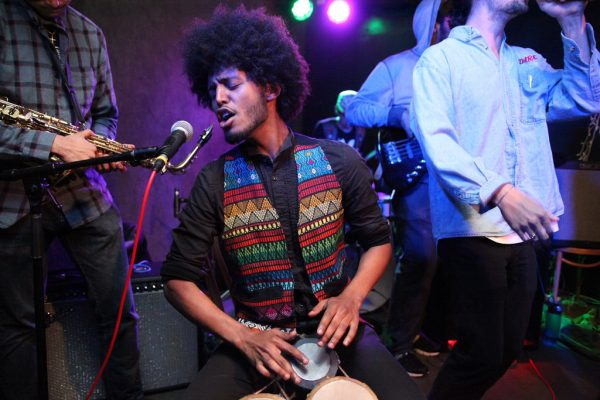 The Pull's Mazin Mahgoub sings and plays the bongos at The Depot for Battle of the Band's 2014 Wednesday, April 9. Photo by Lorisa Salvatin / Xpress