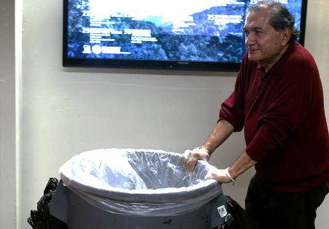 Carlos Rosales a custodian for 22 years at SF State pushes a trash can around the bottom floor of the Cesar Chavez Student Center at SF State Tuesday, September 2, 2014 in San Francisco, Cali.  SF State custodian's work hard everyday to help SF State stay pristine. Custodian's help keep SF State clean. Amanda Peterson / Xpress