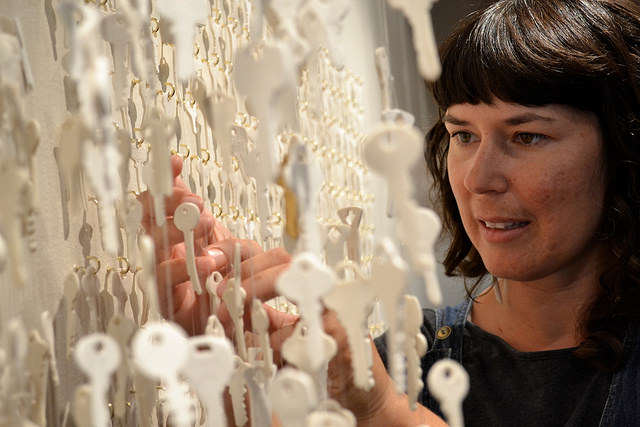 """Despite a meticulous transport, SF State alumna Shenny Cruces untangles knots in her """"Keys"""" installation during a reception in the Alumni Hall Art Gallery Friday, Sept. 19. The exhibit will remain on display  in the Administration Building until January 5, 2015. Annastashia Goolsby / Xpress."""