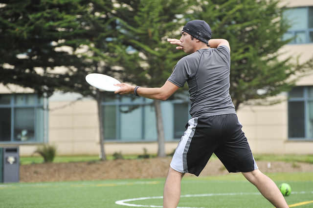 Cloud Monteclaro, 18, throws a disc during Ultimate Frisbee Club practice on the West Campus Green on Friday, Sept. 12, 2014. Sara Gobets / Xpress.