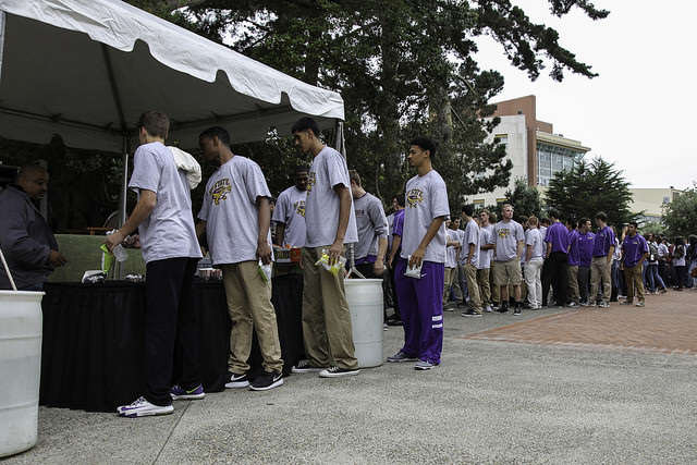 Sporting new t-shirts, SF State athletes line up for free food in Don Nasser Family Plaza just before the reopening ceremony of the newly remodeled gymnasium on Thursday, Sept. 11, 2014. Frank Ladra / Xpress.