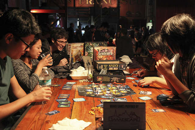 """Gaming fans engage in a strategic board game at the """"Churning the Butter"""" event at the Folsom Street Foundry on Thursday, Sept. 11, 2014. Frank Ladra / Xpress."""