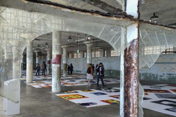 """Alcatraz visitors observe Ai Weiwei's """"Trace"""", an art installation of over 175 portraits made entirely of LEGO, each face depicting a subject of political detainment, Saturday, Sept. 27, 2014. Jenna Feeley / Xpress."""