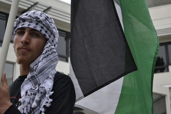 An anonymous supporter of SF State's General Union of Palestine Students gathers at the Malcolm X Plaza Tuesday, Sept. 30 in remembrance of the Sabra and Shatila massacre of 1982. Annastashia Goolsby / Xpress.