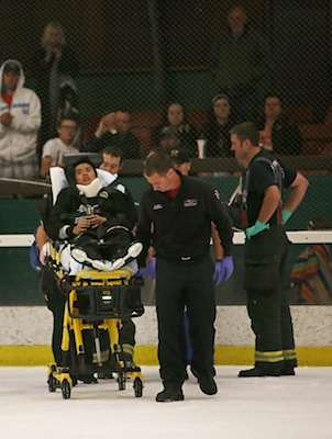 Brian Lu, #15, is led off the ice on a stretcher after he took a hard hit against the Santa Rosa JC Polar Bears at Snoopy's Home Ice on Friday, Oct. 3, 2014. Sara Gobets / Xpress.