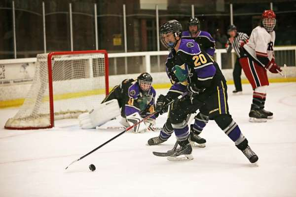 SF State Gator Jonathan Stolan, #20, clears the puck after goalie Ryan Papazian, #41, deflects a shot on goal during a game against the Santa Rosa JC Polar Bears at Snoopy's Home Ice on Friday, Oct. 3, 2014. Sara Gobets / Xpress.