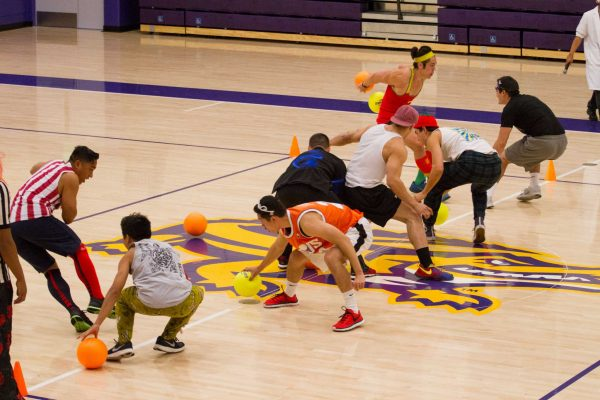 "Teams Bobby ""Small Hands"" Medina and The Milkman go head to head at the beginning of the final round of SF State's Annual Costume Dodgeball Tournament from 7-10 p.m. Friday, Oct. 24, 2014, in the Gymnasium. Eric Gorman/Xpress."