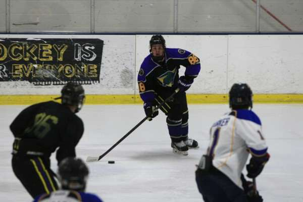 Gator Michael Parra, #88, looks to Corey Bemis, #96 to pass the puck at the Oakland Ice Center, home of the SF State Gators, in Oakland, Calif., on Friday October 24, 2014.  The Gators lost to the Spartans 12-0. Daniel Porter/Xpress.