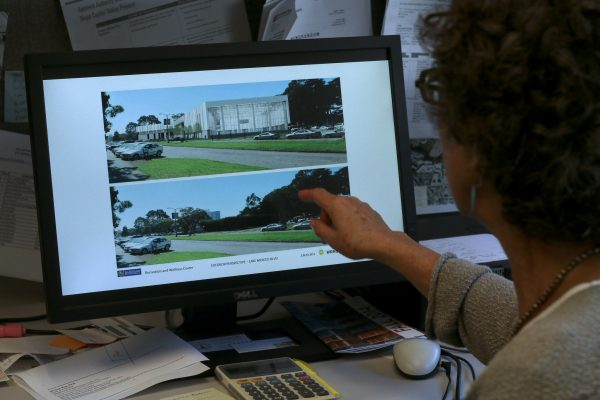 Wendy Bloom, Campus Planner points to a before and after illustration at her computer of the wellness center is being built at SF State at Font and Lake Merced Boulevards Monday, Oct. 13, 2014. The center will open in 2018, free for SF States and a fee for faculty. Amanda Peterson / Xpress.