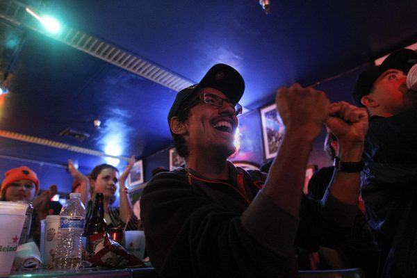 Juan Santamaria, a senior Latin studies major, cheers for the Giants during the bottom of the ninth inning during Game 1 of the World Series with the SF Giants against the Kansas City Royals at the Pub at SF State Tuesday, Oct. 21, 2014. Daniel Porter / Xpress.