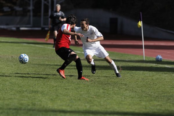 Gator Kevin Johnson, #4 senior, tries to keep the ball from Hawaii Hilo Vulcan Cristian Ruelas, #22 junior, in Cox Stadium at SF State Wednesday, Oct. 22, 2014. The SF State Gators beat the Hawaii Hilo Vulcans 1-0 in over time. Daniel Porter/Xpress.