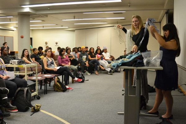 Students gathered in the Rosa Parks conference room to take part in the EROS (Educational and Referral Organization) workshop for Sexuality kink and bondage Wednesday, Oct. 29, 2014. Here professional kinkster, Shay Tiziano (left) and her assistant Jade Taylor, pass out scarves to students, so they can practice their knot tying. Helen Tinna/Xpress.