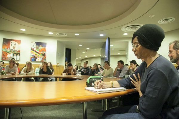 """Landa Williams, senior majoring in liberal studies, takes notes as Randy Borman speaks to a crowd after viewing the documentary """"Oil & Water"""" in Richard Oakes Multicultural Center Wednesday, Nov. 5, 2014. Martin Bustamante/Xpress."""