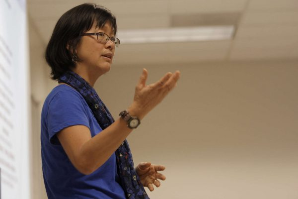 Grace J. Yoo, a professor in the Asian-American studies department, introduces the first speaker during the Violence Teach-In at SF State Tuesday, Nov. 4, 2014. Daniel Porter/Xpress.