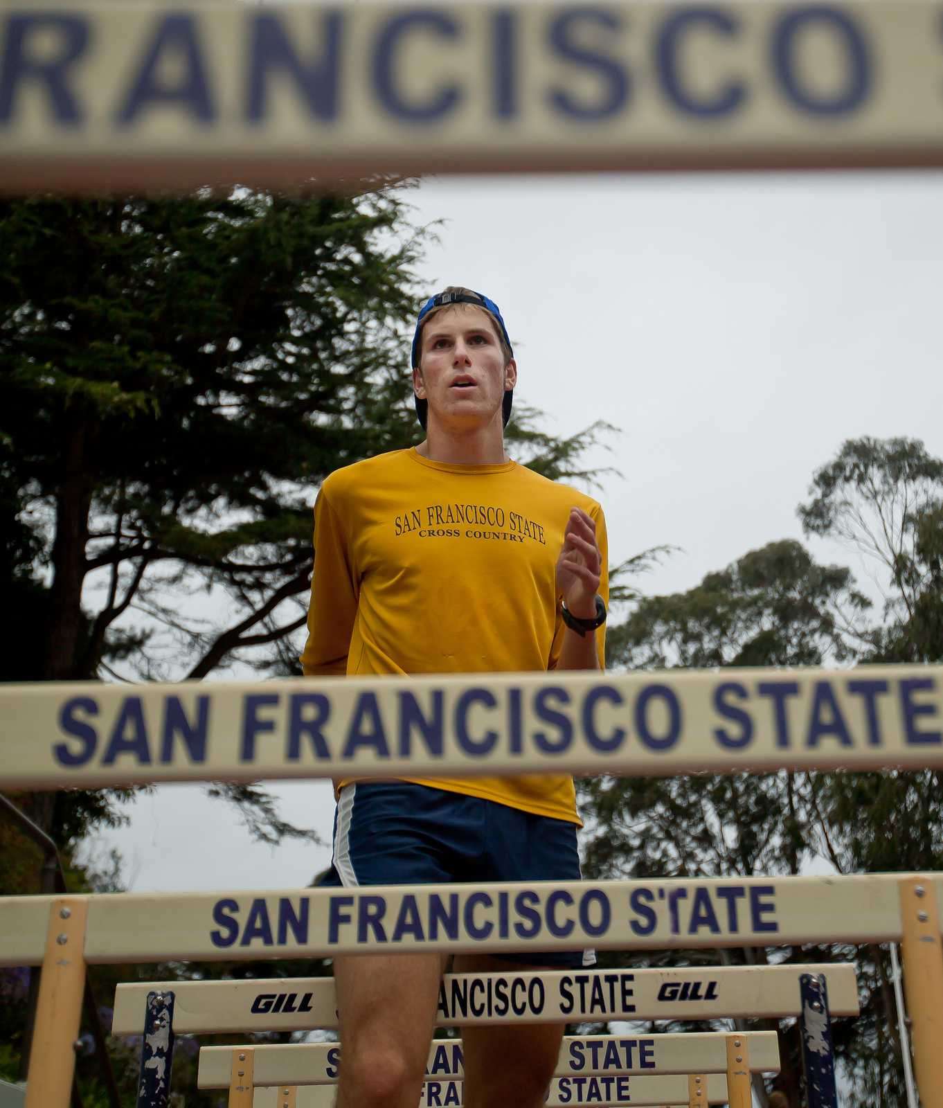 SF State cross country runner Drew Feldman runs drills with his team after a 10 mile run in Golden Gate Park on Thursday, Aug. 22, 2013. Photo by Dariel Medina / Xpress