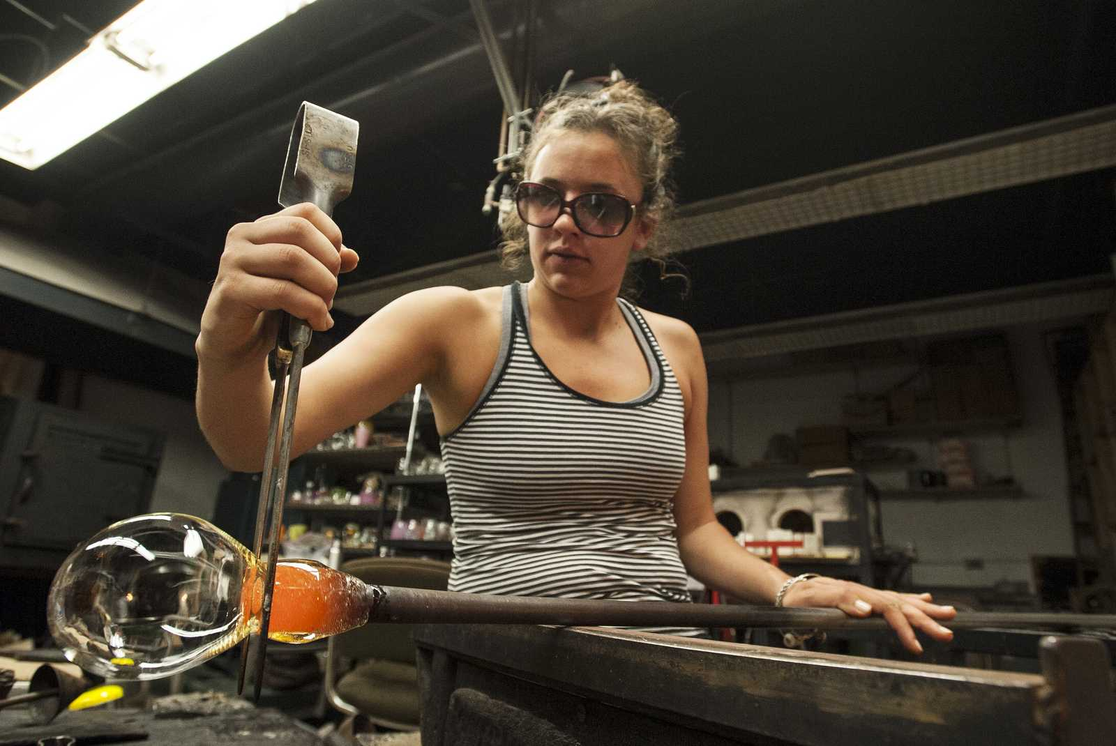 Rachel Beck uses a Jack to shape a piece of glasswork in the Fine Arts building Tuesday, Sept. 17, 2013. Photo by Benjamin Kamps / Xpress