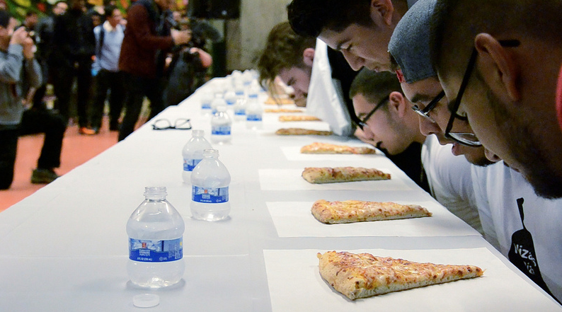 Pizza-eating contest won by unexpected non-student at Nizario's grand opening