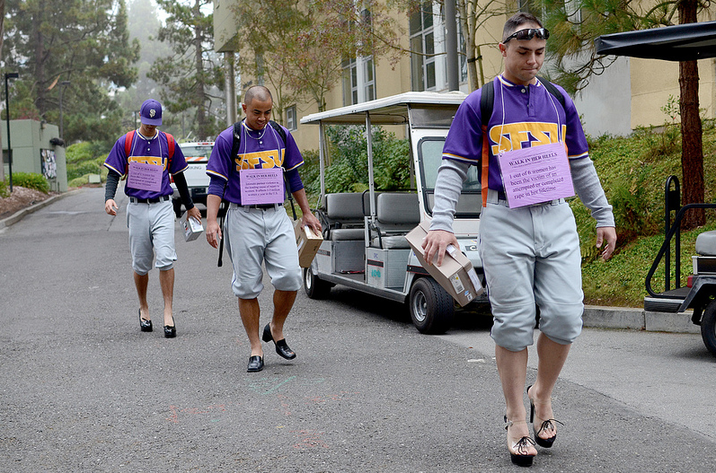 Male students walk campus in heels to educate on sexual violence