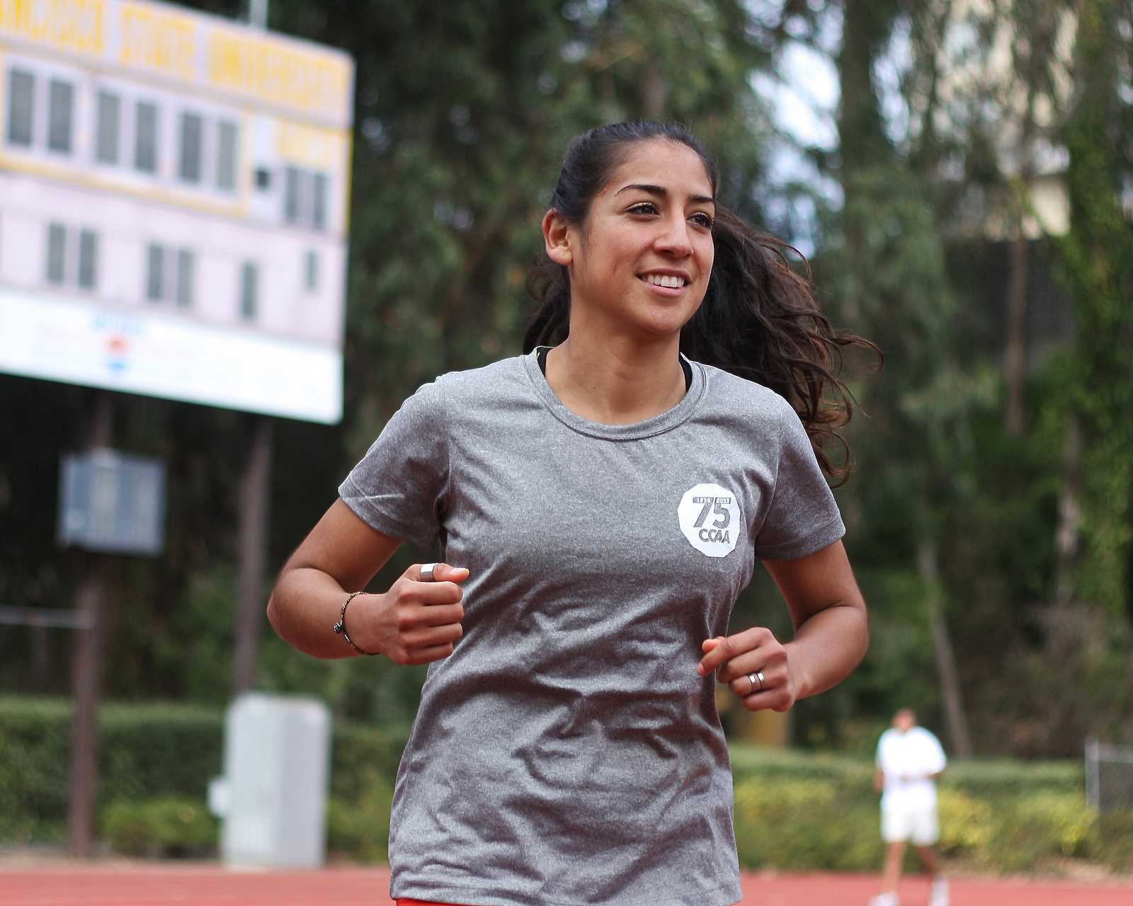 Cross-country runner strives for nationals despite lingering injury
