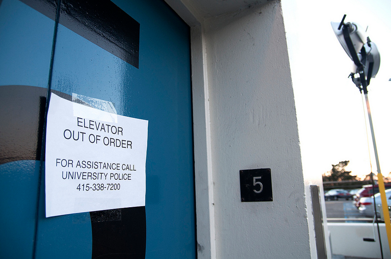 An out of order sign is displayed on an SF State Lot 20 parking structure elevator during a power outage that occurred Monday, Dec. 9, 2013. The elevators are expected to remain out of order on Tuesday, Dec. 10, 2013, but the rest of the structure now has power. Photo by Jessica Christian / Xpress