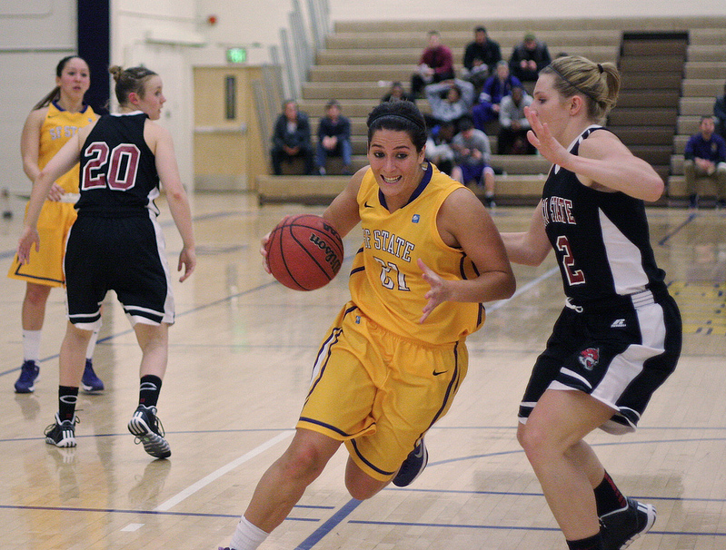 Katie Batlin (#21) dodges the other team at the SF State vs. Chico State Women's Basketball game at the Swamp Friday, Dec. 6, 2013. Photo by Ryan Leibrich / Xpress