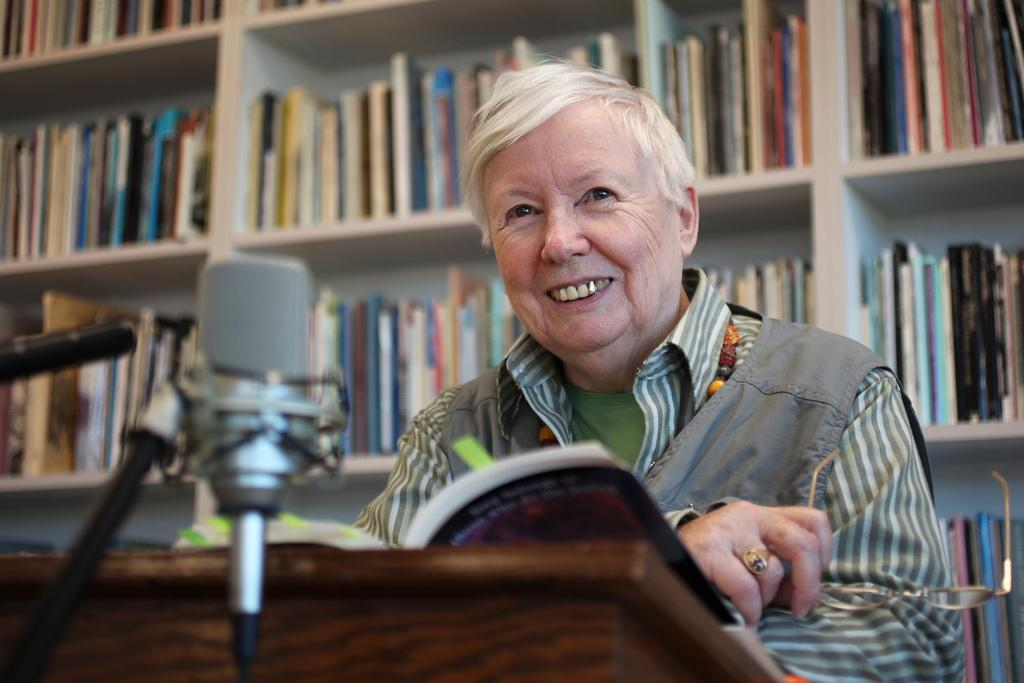 "Judy Grahn shares a smile with the audience as they laugh at an excerpt from her book ""Love Belongs to Those Who Do the Feeling"" during her poetry reading at the Poetry Center, Thursday Feb. 20. Photo by Lorisa Salvatin / Xpress"
