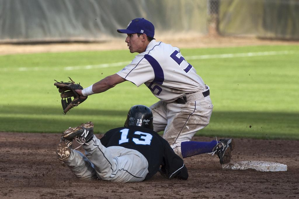SF State infielder Fernando Escobar tries to tag out CSU San Bernardino's Spencer Bayless as he slides into second base during a home game at Mahoney Field Friday, Feb. 28. Photo by Jessica Christian / Xpress
