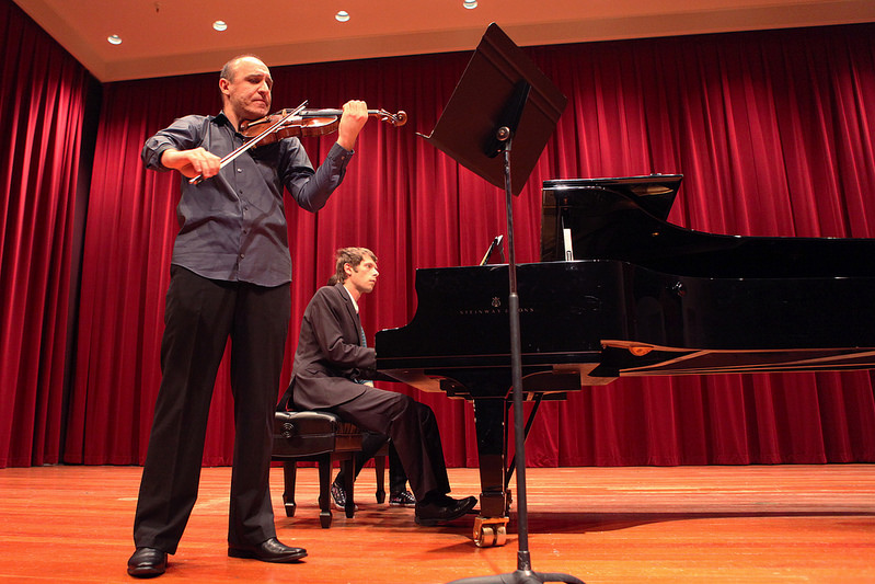 Associate Professor Jassen Todorv and graduate student Adrian Borcea play three of Mozart's Sonatas on violin and piano in Knuth Hall Wednesday, Feb. 5. Photo by Lorisa Salvatin / Xpress