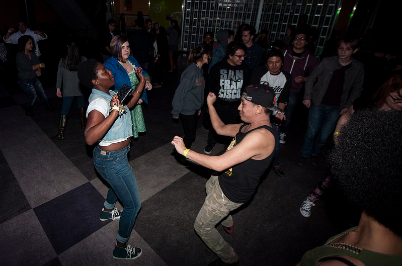 Jillian Patterson (left), SF State freshman, and Ace Prado (right), SF State sophomore, dance at Back in the Rhythm: Noise Complaint in the Student Center Friday, Jan. 31, 2014. Photo by Rebekah Didlake / Xpress