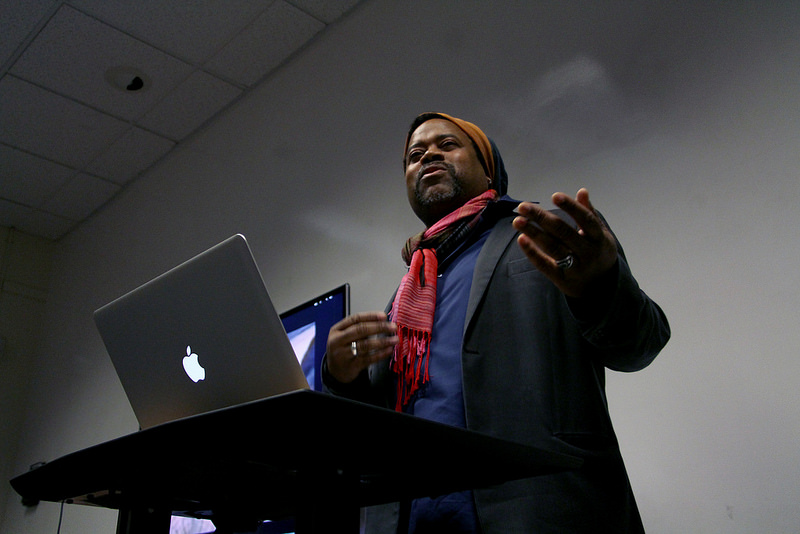 Greg Tate, a writer and musician, answers a students question on the state of hip-hop at an event held by the Africana Studies department, on black arts and Afrofuturism, in SF State's Ethnic Studies and Psychology building, Monday, Feb. 17th, 2014. Photo by Gavin McIntyre / Xpress