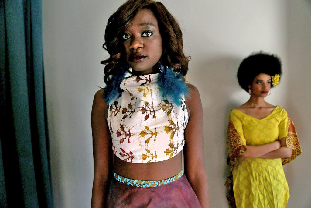 Nchimunya Milambo  and Torii Martin wait backstage at the Pan African Fashion Show in Jack Adams Hall Tuesday, March 18.