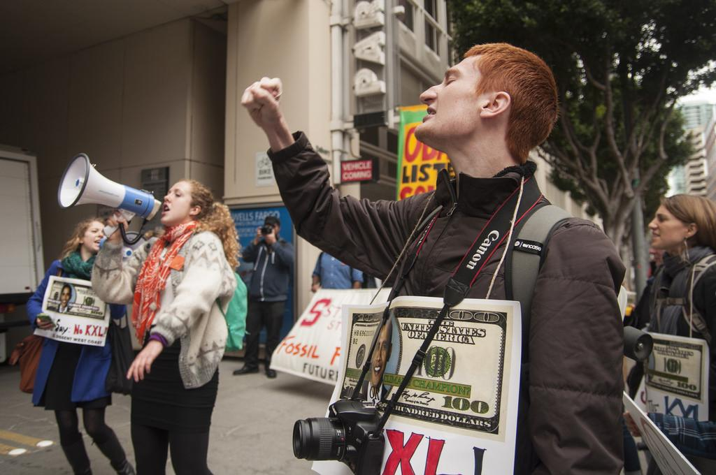 SF State student Cain Buckler, member of Fossil Free SF, chants with fellow demonstrators at the State Department building in downtown San Francisco during a protest held against the possible Keystone XL pipeline Monday, March 3. Photo by Jessica Christian / Xpress